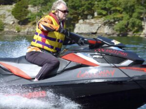 The Intrepid Cottager riding a Sea-Doo watercraft