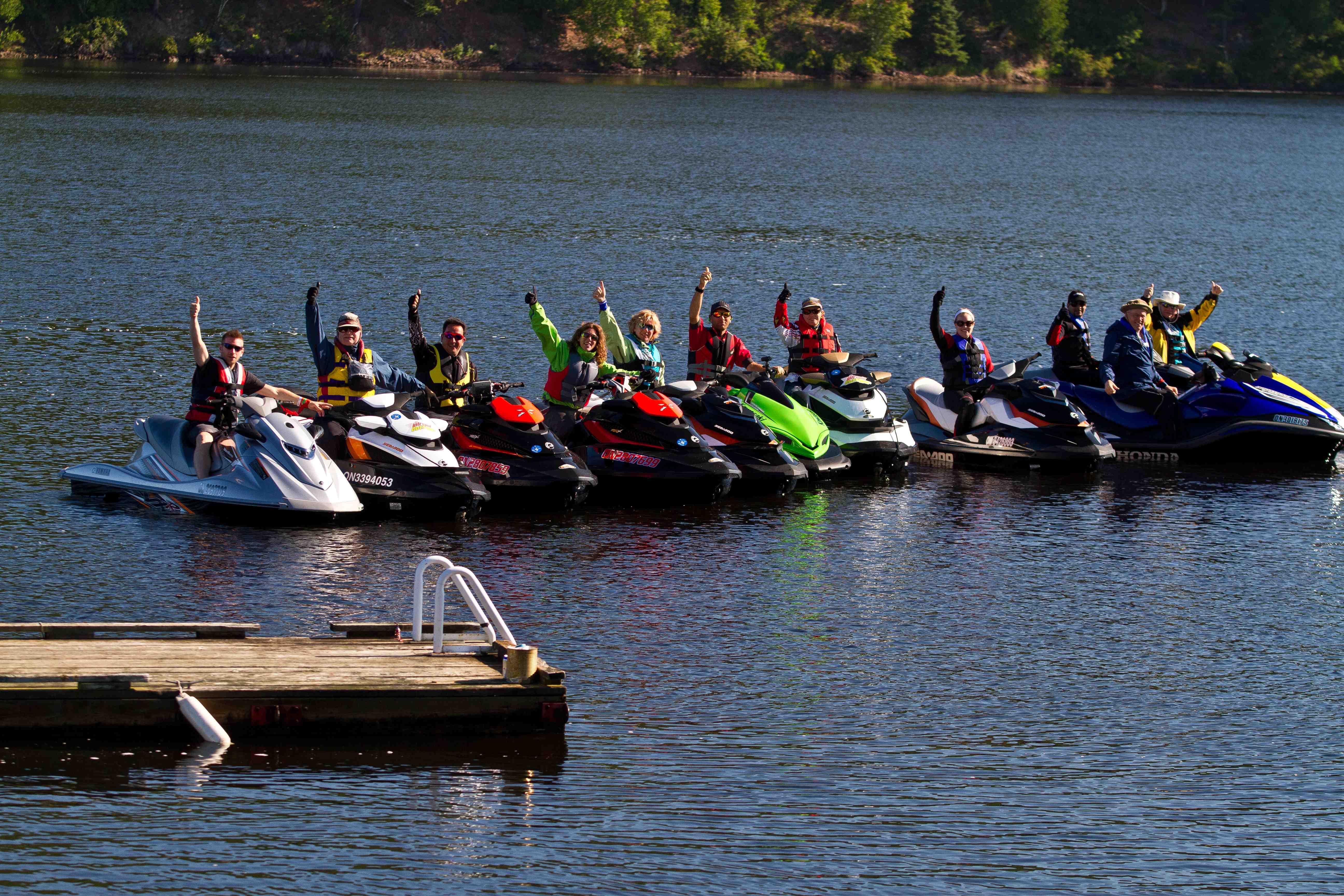 Photo of riders waving on Ottawa River Sea Doo Tour Blast