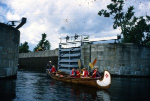 Young campers in war canoes on theRideau Canal Sea Doo Tour