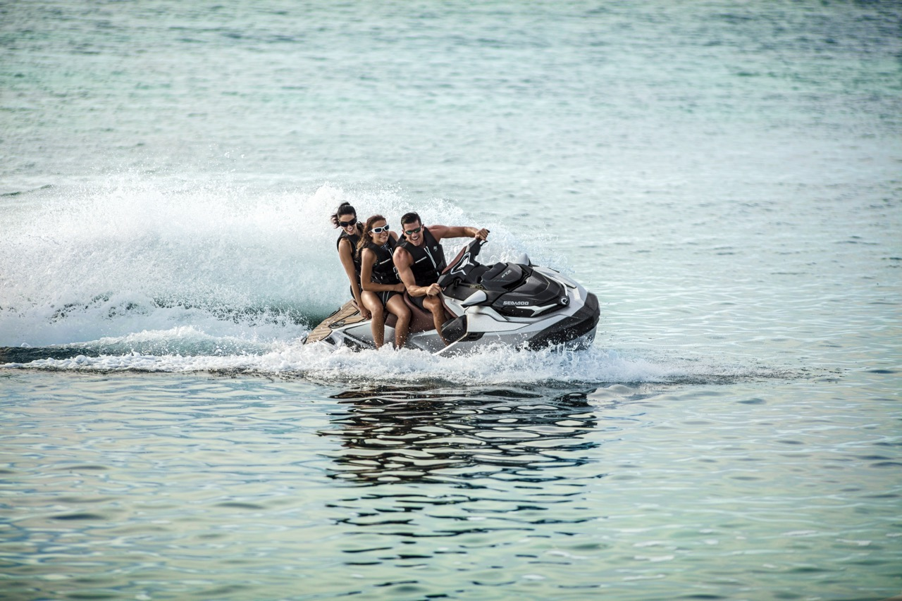 Three people riding Sea Doo ST3 Hull on 2018 GTX Limited