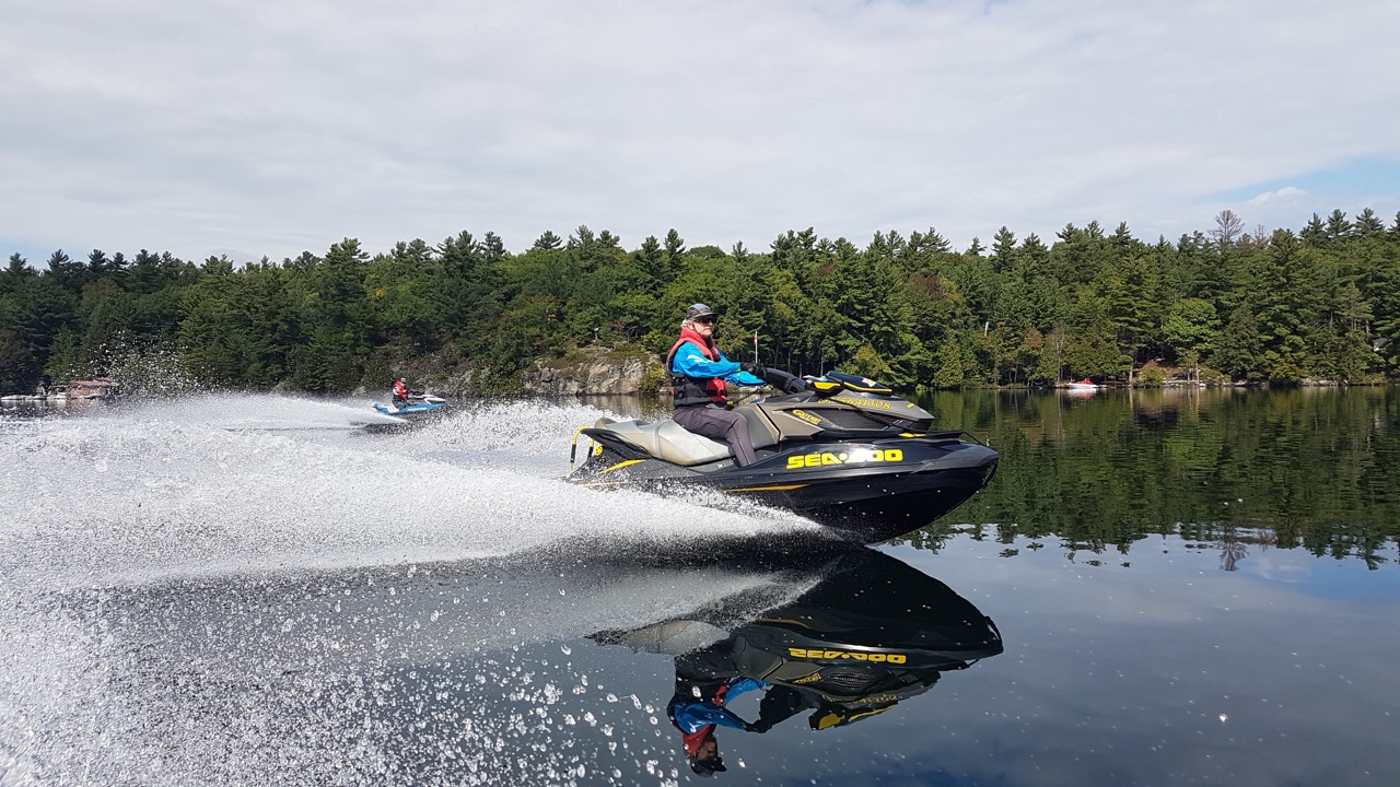 Two Sea Doo riders enjoying a Muskoka fall Sea Doo tour