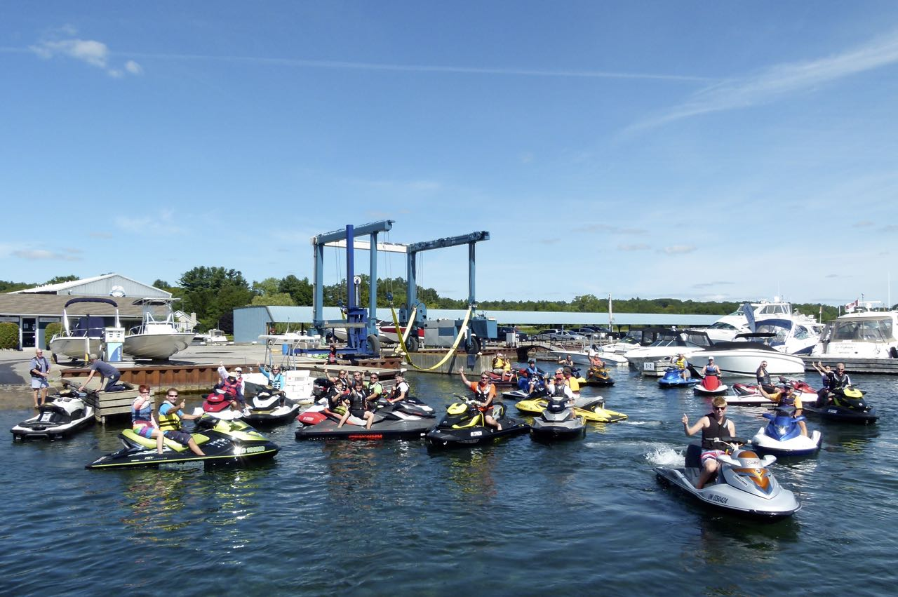 Large group riding participants staging from a marina