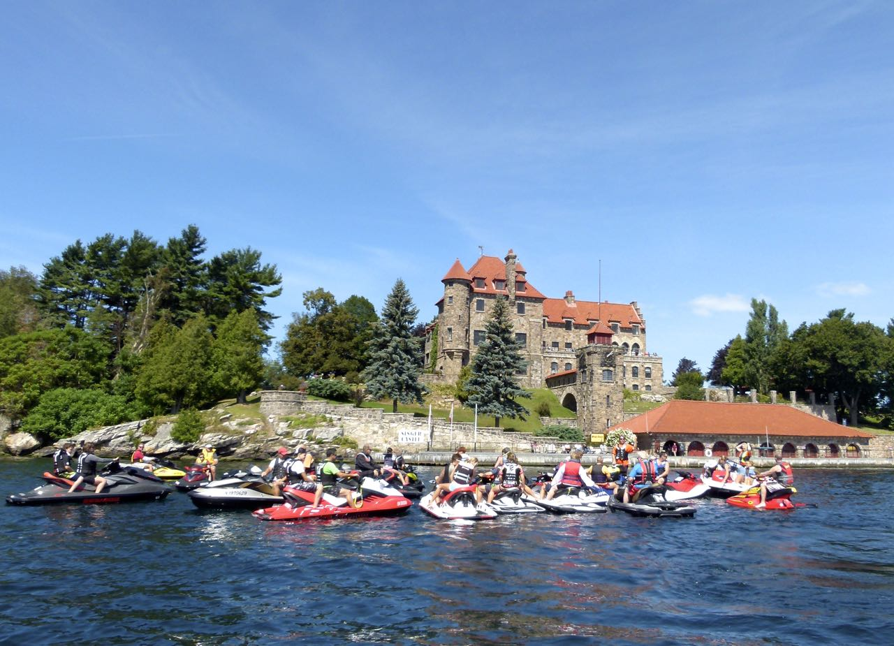 Large PWC group riding participants in front of Singer Castle, 1000 Islands