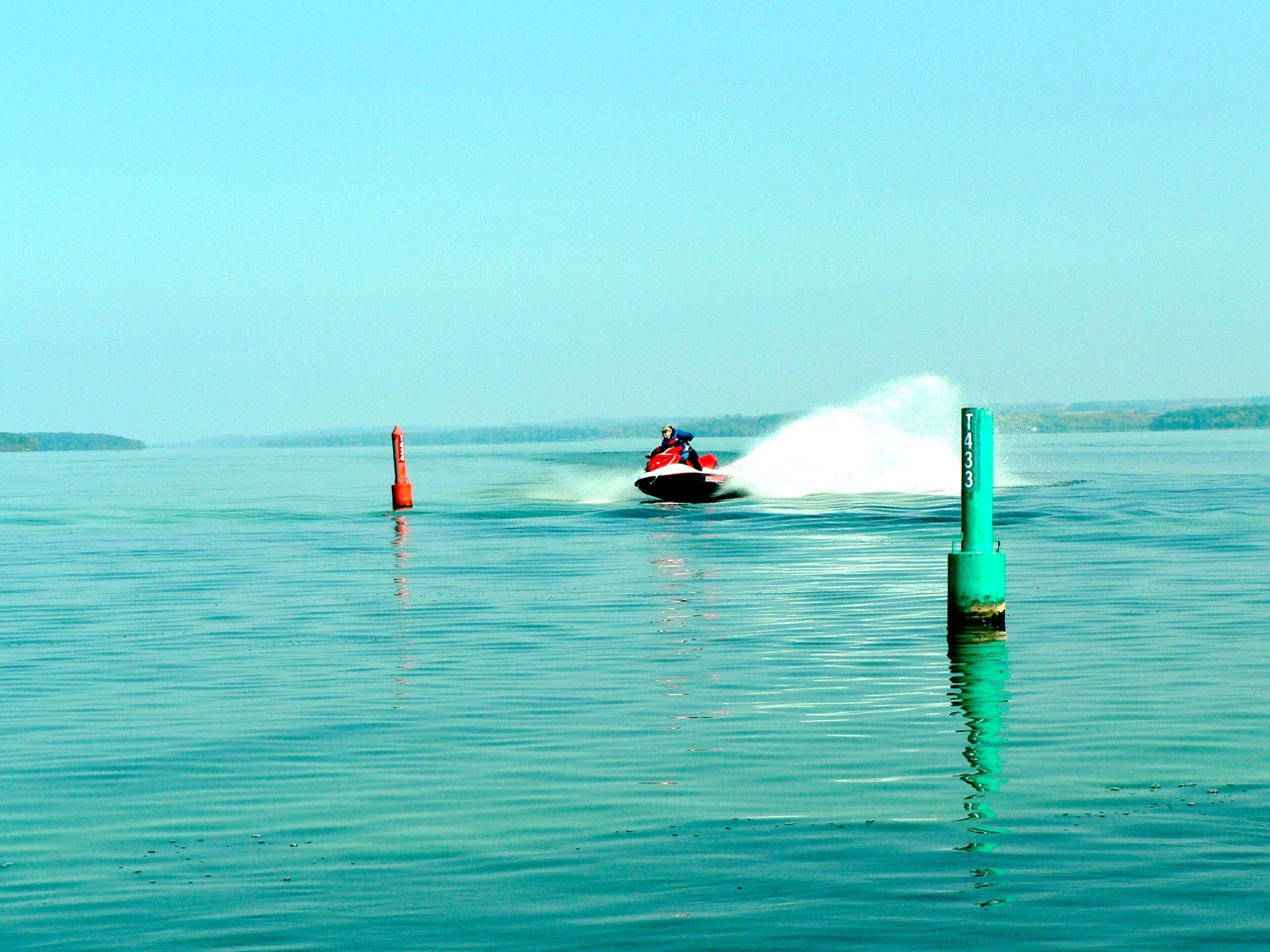 Following Coast Guard navigation buoys on unfamiliar waters is another of many PWC beginners tips.